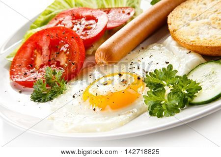 Breakfast - fried egg and sausages