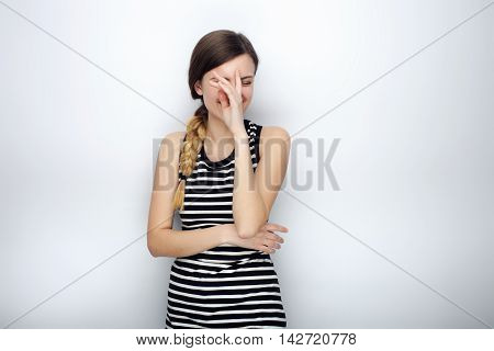 Portrait Of Happy Laughing Young Beautiful Woman In Striped Shirt Doing Facepalm Posing For Model Te