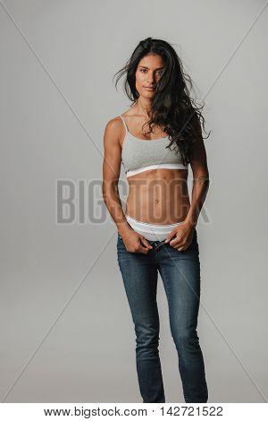 Slightly Muscular Woman Opening Pants Zipper