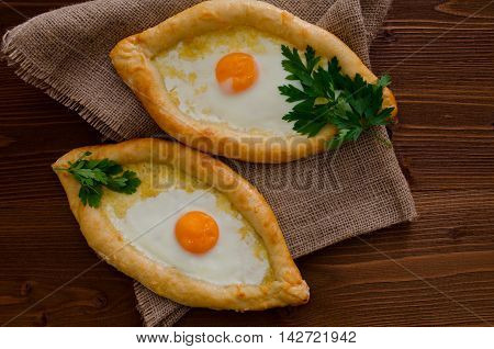 Fresh and fragrant khachapuri on a wooden table