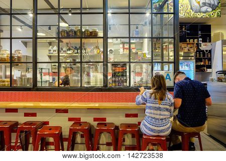 Los Angeles, USA - August 8, 2016 : Couple having meal at Cool decoration of Knead & Co Pasta Bar and Market at Grand Central Market, famous place for dining and traveling in downtown LA.
