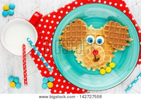 Puppy dog waffles for baby breakfast. Animal-shaped adorable art food for kid. Creative idea for child fun dessert or breakfast