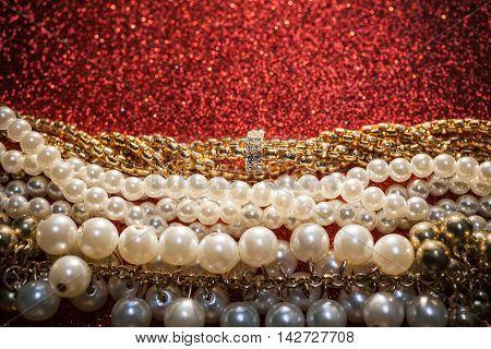 Luxury beautiful jewelry on a red glitter background.