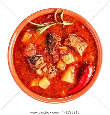 Bowl of goulash. Traditional hungarian meal. Top view. Isolated on white
