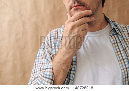 Man stroking chin and thinking deep thoughts making tough decisions
