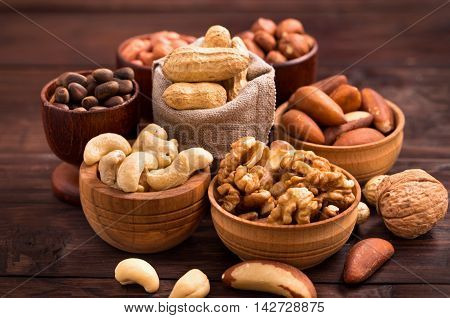 Variety of nuts: walnut, hazelnut, cashew, peanuts,  pine nuts and other