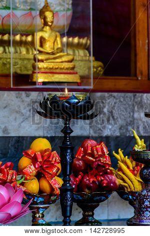 Hopeful Light Before Buddha