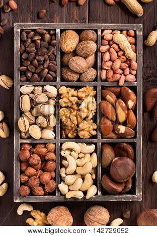 Box of variety nuts top view on dark