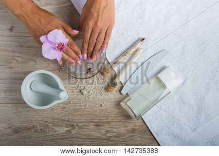 Woman having a spa manicure in beauty salon