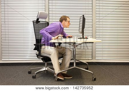 Near-sightedness,  myopia. Office worker at work station