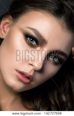 Portrait Of Young Beautiful Woman With Bridal Makeup And Coiffure. Modern Smokey Eyes Make Up. Studi