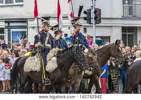 WARSAW POLAND - AUGUST 15 2016: Armed Forces Day is a national holiday commemorating the anniversary of the 1920 victory over Soviet Russia at the Battle Of Warsaw during the Polish-Soviet War. Volunteers appearing in historical dress from past wars.