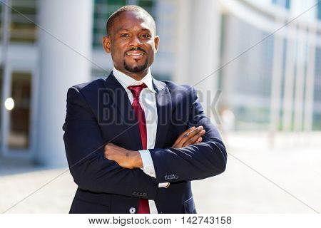 Smiling african businessman outdoor