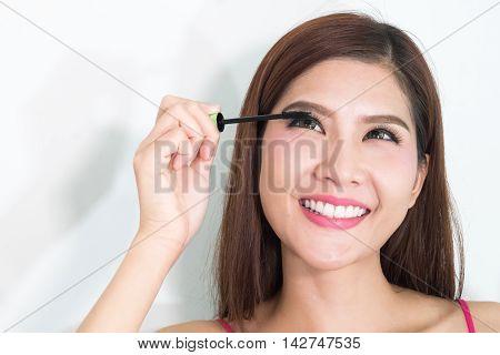 Makeup Woman Putting Mascara Eye Make Up On Eyes. Asian Fresh Face Girl Looking In The Mirror Lookin
