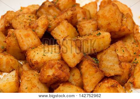 Spicy fried potaoes with wedges Indian delicay