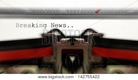 Old typewriter typping word  breaking news with blur motion