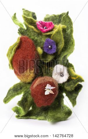 Brooch made of felt wool on a white background