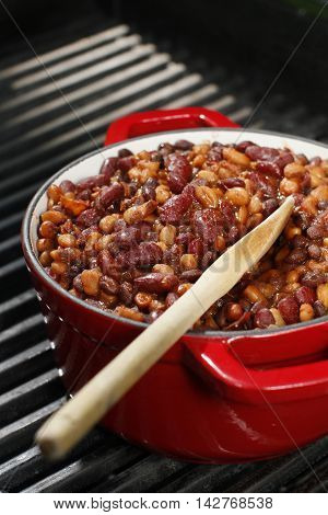 Baked beans on red stew on the grill