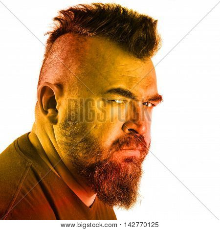 close-up portrait profile of an angry white man with mohawk and beard Instagram aafilter