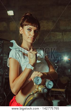 Mechanic Woman In Sexy Uniform Is Holding A Spanner