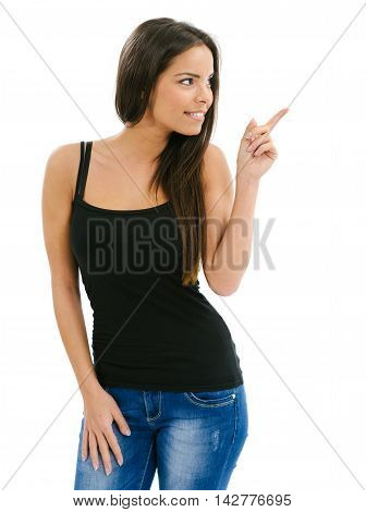 Photo of an isolated beautiful young woman pointing at something on her left.