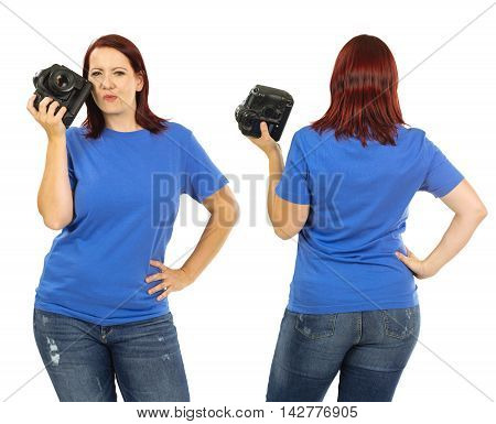 Photo of a woman posing with a blank blue t-shirt and holding a camera ready for your artwork or design.