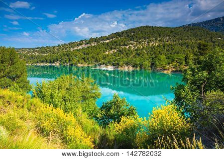 The biggest mountain canyon in Europe - Verdon. Spring Provence. Smooth-blue water reflecting the clouds