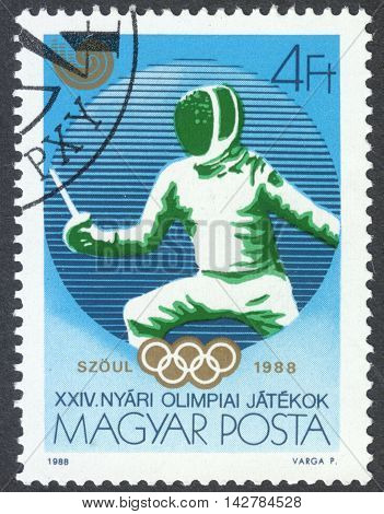 MOSCOW RUSSIA - CIRCA JUNE 2016: a post stamp printed in HUNGARY shows fencing the series