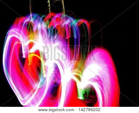 Light motion in heart shaped on the dark background