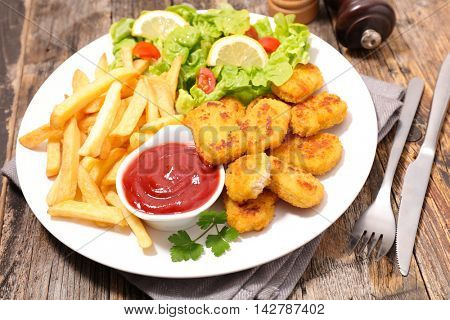 fried chicken with french fries and salad