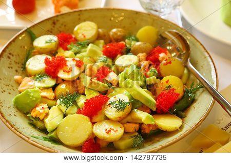 european cuisine avocado quail egg and potato salad with red caviar