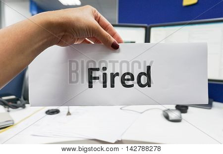 boss hold a paper of fired employee