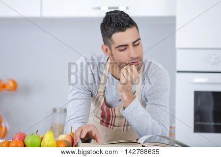 man cooking at his kitchen eastern cuisine