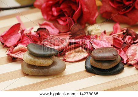 Stones and petals for aromatherapy session