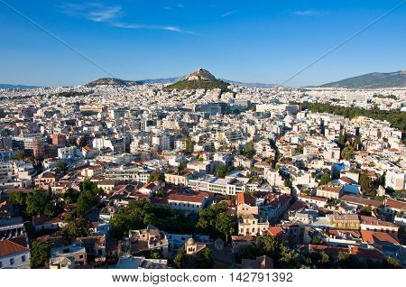 View of Athens and Mount Lycabettus in Athens Greece.