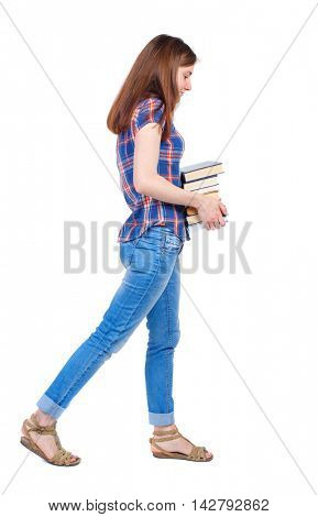 Girl comes with  stack of books. side view. Rear view people collection.  backside view of person.  Isolated over white background. Girl in a plaid shirt goes to the sad side with textbooks.