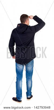 Back view of handsome man in winter jacket  looking up.   Standing young guy in parka. Rear view people collection.  backside view of person.  Isolated over white background. A guy in a black jacket