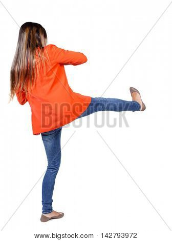 back view of woman funny fights waving his arms and legs. Rear view people collection. backside view of person.  Isolated over white background.  student in the red jacket has a foot.