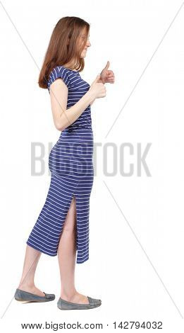 Back view of  woman thumbs up. Rear view people collection. backside view of person. Isolated over white background. The brunette in a blue striped dress is cancer and shows a thumbs-up sign of