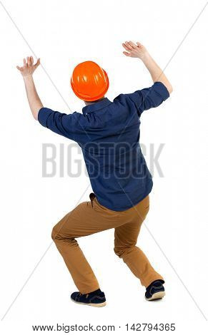 back view business man protective construction helmet protects hands from what is falling from above. Rear view people collection.  backside view of person.  Isolated over white background. The