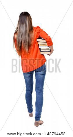 Girl comes with  stack of books. back side view. Rear view people collection.  backside view of person.  Isolated over white background. student in red jacket goes away with a lot of books under his
