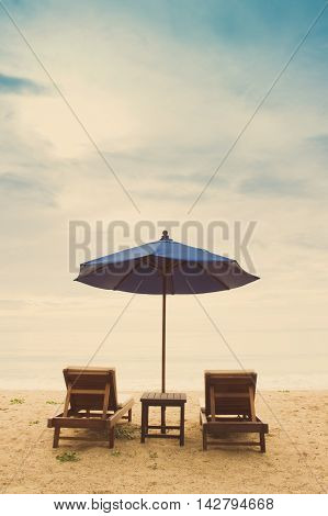 holiday beach with beach chair and beach unbrella process photo with vintage style