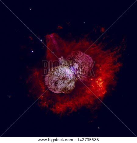 The Homunculus Nebula is a bipolar emission and reflection nebula surrounding the massive star system Eta Carinae. Retouched colored image. Elements of this image furnished by NASA.