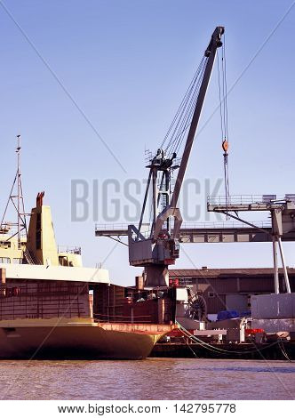 Freight shipping scene at a container harbor. Industrial ship at a dock.