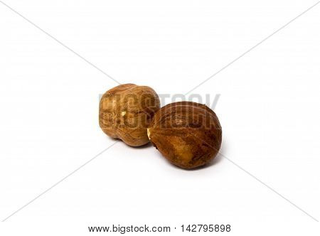 view of two peeled hazelnuts isolated on a white background closeup