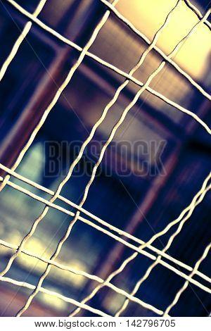 Prison cell with bent bars, jail break scene.