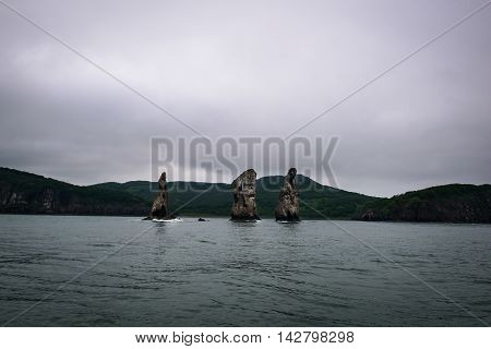 The Three Brothers, a famous rock formation in the Avacha Bay area near Petropavlovsk-Kamchatsky, Kamchatka, Russia