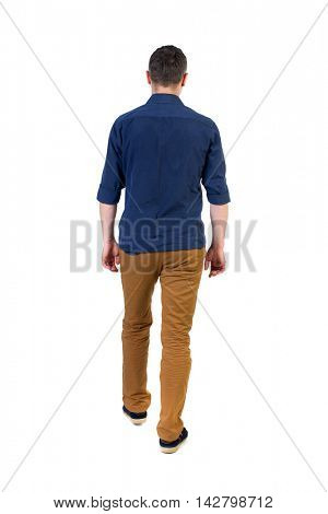 Back view of going  handsome man. walking young guy . Rear view people collection.  backside view of person.  Isolated over white background. a man in a blue shirt with the sleeves rolled up out of