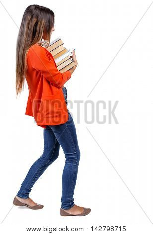 Girl comes with  stack of books. side view. Rear view people collection.  backside view of person.  Isolated over white background. girl in a red jacket with a corpse carries a lot of books.