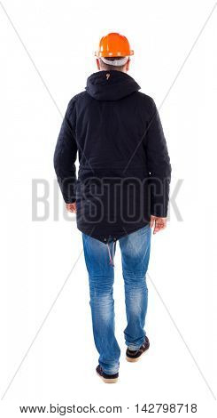 Back view of walking engineer in helmet.  Rear view people collection. Backside view of person. Isolated over white background. Engineer in warm clothing is in a helmet